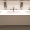 Corian Energy 7720 project wastafel - Dyson water tab - front