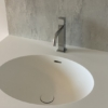 Ovale Solid Surface spoelbak - Incollato Oval - Corian Neutral Aggregate achterwand - frontview 840x560
